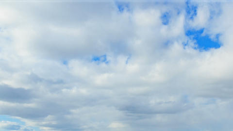 Spring clouds on a blue sky day. Time Lapse Footage