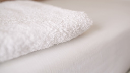 Woman smoothing a fresh white towel Stock Video Footage