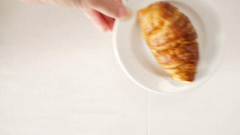 Coffee and croissant for breakfast Stock Video Footage