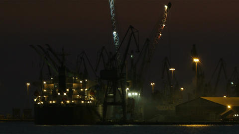 Unloading cargo ship at night 1 Footage