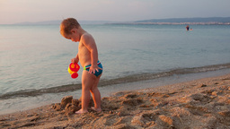 Little boy on the beach at sunset Stock Video Footage