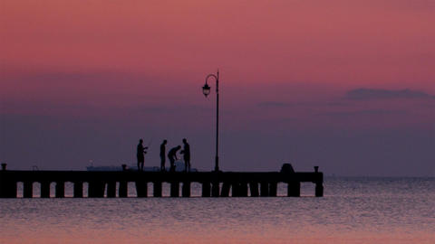 People On A Pier At Sunset stock footage