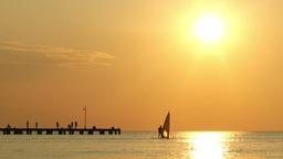Man windsurfing at sunset Stock Video Footage