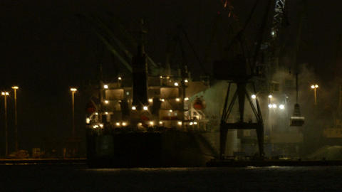 Unloading cargo ship at night 2 Stock Video Footage