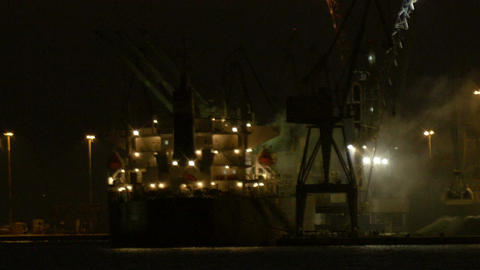 Unloading cargo ship at night 2 Footage