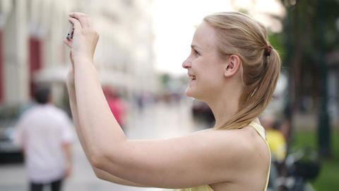 Woman taking a photo while sightseeing Stock Video Footage