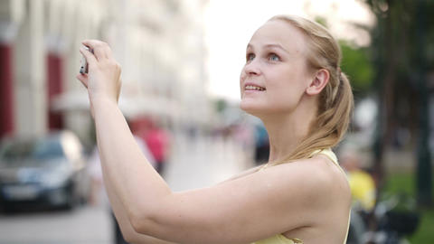Woman taking a photo while sightseeing Footage