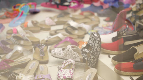 Young girl passing by a shoe shop Stock Video Footage