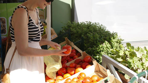 Young woman shopping for fresh vegetables Stock Video Footage