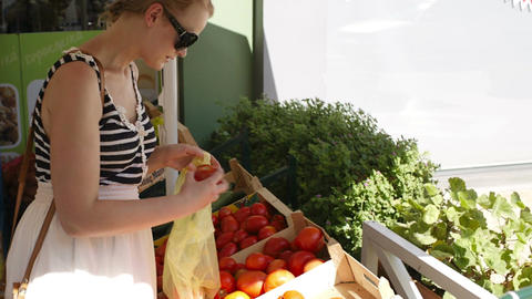 Young woman shopping for fresh vegetables Footage