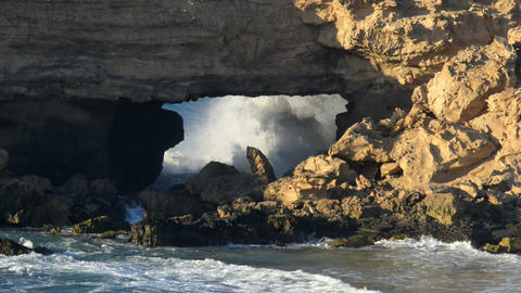 big waves braking in sandstone bridge cave 11115 Footage