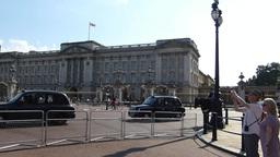 Police patrolling near Buckingham Palace & heading Stock Video Footage