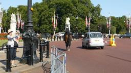 Police on horse heading towards Buckingham Palace Footage