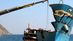 DISMANTLEMENT OF WRECKED SHIP Stock Video Footage