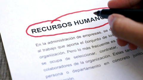 Circling Human Resources with a pen (In Spanish) Stock Video Footage