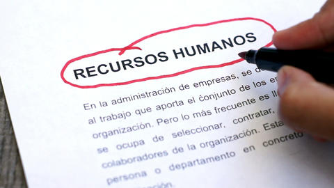 Circling Human Resources with a pen (In Spanish) Footage