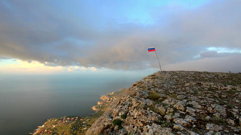 Russian flag on the top of a mountain on the backg Stock Video Footage