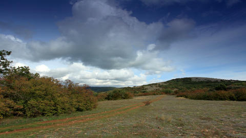 Movement of the clouds on the mountain on a dirt r Stock Video Footage