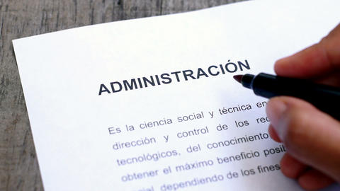 Circling Administration with a red marker (In Span Stock Video Footage