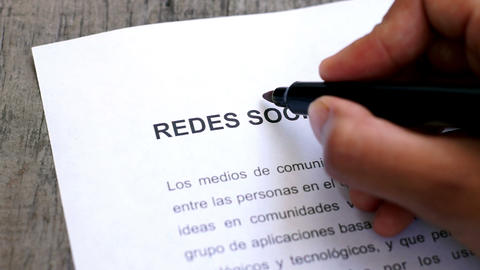 Circling Social Media with a pen (In Spanish) Stock Video Footage