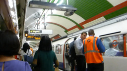 London tube arrived at station and make announceme Stock Video Footage