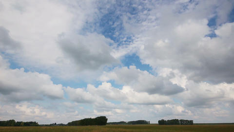 timelapse with clouds moving over field Stock Video Footage