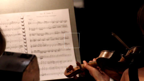 musician playing on violin in orchestra Stock Video Footage