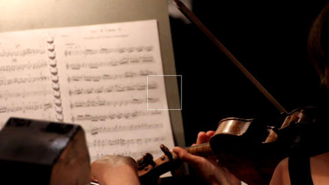 musician playing on violin in orchestra Footage