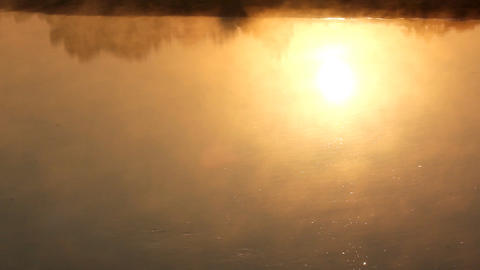 sunrise reflection in the river with mist Stock Video Footage