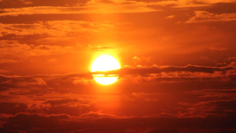 dramatic red sunrise on dark cloudy sky Stock Video Footage