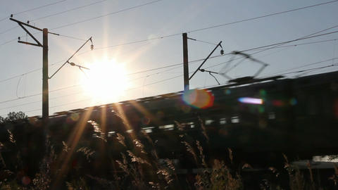 passenger train against sunset Stock Video Footage