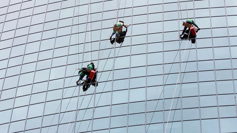 Window Cleaners At Work On Skyscraper stock footage