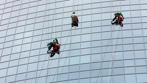 window cleaners at work on skyscraper Stock Video Footage