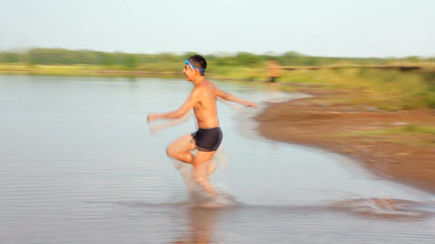 boy jumping in lake - summer vacations Stock Video Footage
