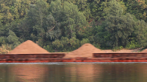 tugboat pushes a barge loaded with sand on the riv Stock Video Footage