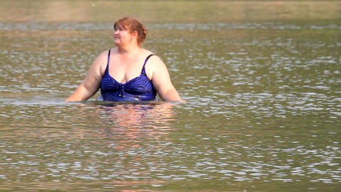 woman with overweight bath in river Stock Video Footage