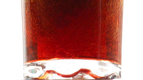 cola is poured into a glass close-up - slow motion Footage