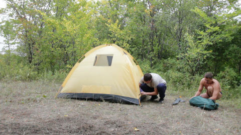 Two men removed a tent Stock Video Footage