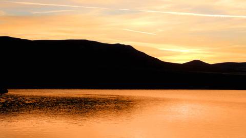 sunrise on morning lake with mountain Footage