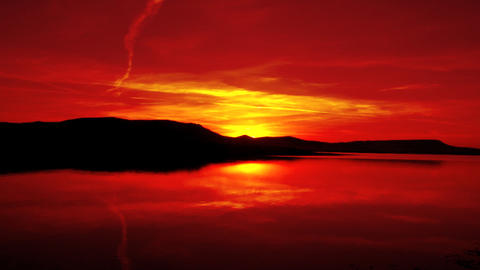 red sunrise on morning lake with mountain Footage