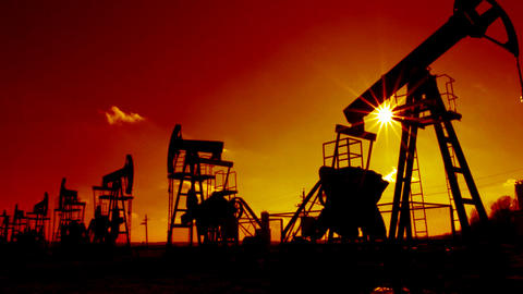 row of many working oil pumps silhouette against s Stock Video Footage