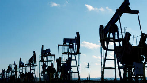row of many working oil pumps silhouette Stock Video Footage