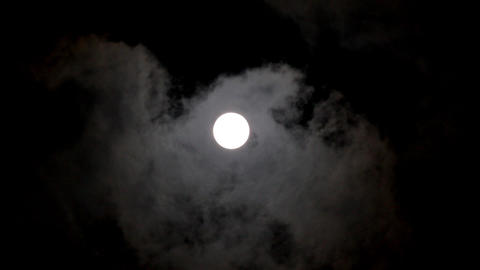 moon moving between clouds Stock Video Footage