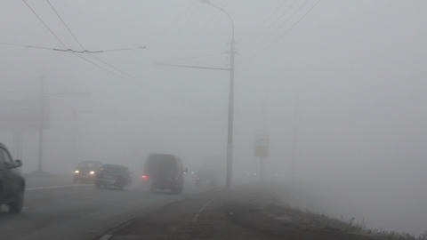 cars moving in the fog - timelapse Stock Video Footage