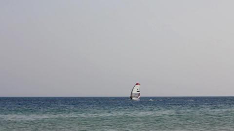 windsurfing - surfers on blue sea surface Stock Video Footage