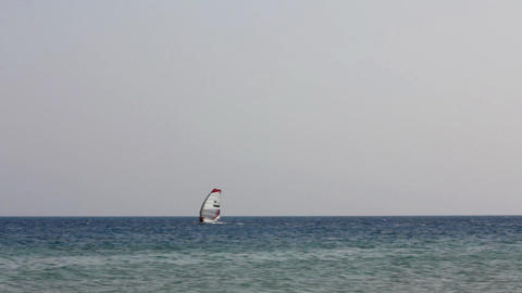 windsurfing - surfers on blue sea surface Footage