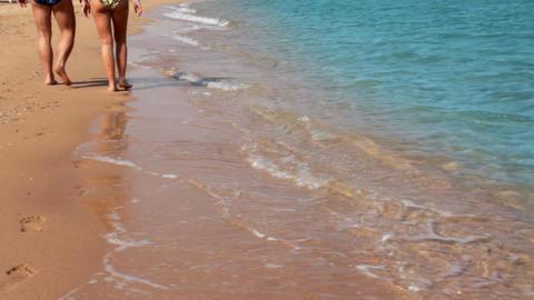 walking couple on beach coastline Stock Video Footage