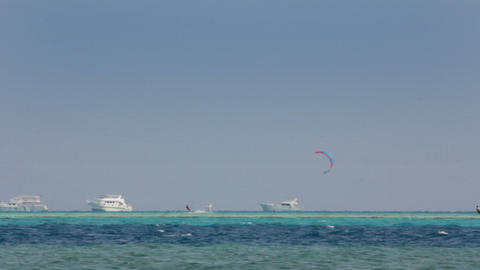 kite surfing - surfers on blue sea surface Footage