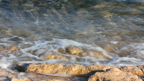turquoise sea water waves and stones close-up Stock Video Footage