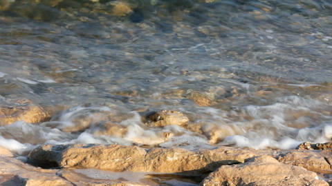 turquoise sea water waves and stones close-up Footage